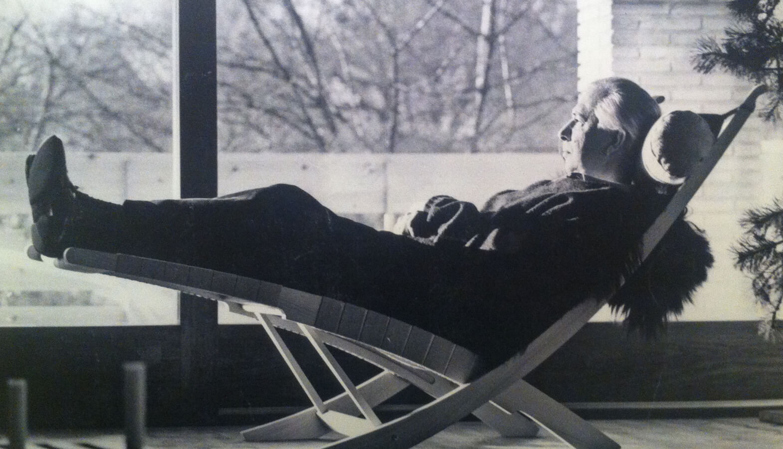 Hans Wegner relaxing in his chair
